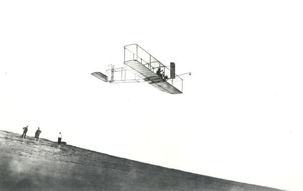 A photograph of Orville Wright in his glider at Kitty Hawk, North Carolina, in 1911. On October 24, 1911 Orville tested a new glider and broke all the previous gliding records by actually soaring and staying in flight for 9 minutes and 45 seconds