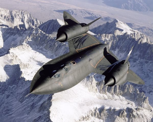 Dryden's SR-71B, NASA 831, slices across the snowy southern Sierra Nevada Mountains of California after being refueled by an Air Force Flight Test Center tanker during a recent flight