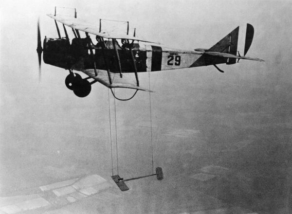 Active aircraft biplane, NACA, with model wing suspended during flight