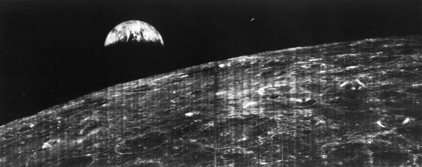 The world's first view of Earth taken by a spacecraft from the vicinity of the Moon. The photo was transmitted to Earth by the United States Lunar Orbiter I and received at the NASA tracking station at Robledo De Chavela near Madrid, Spain
