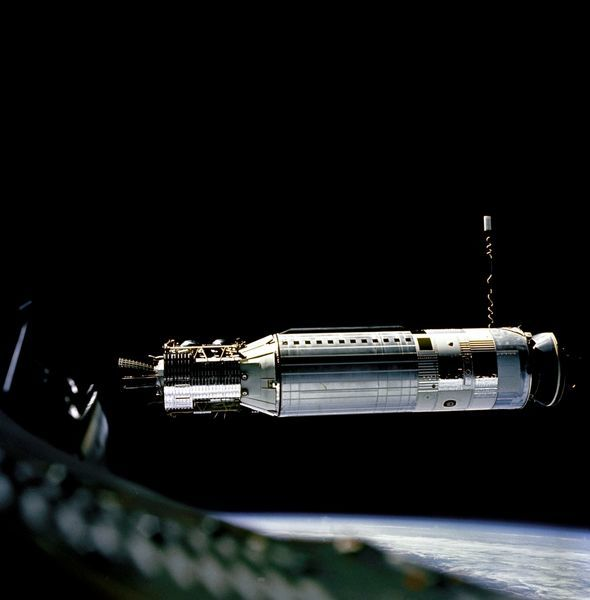 A profile view of the Agena Docking Target Vehicle as seen from the Gemini 8 spacecraft during rendezvous in space