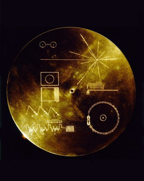 "This gold aluminum cover was designed to protect the Voyager 1 and 2 ""Sounds of Earth"" gold-plated records from micrometeorite bombardment, but also serves a double purpose in providing the finder a key to playing the record"