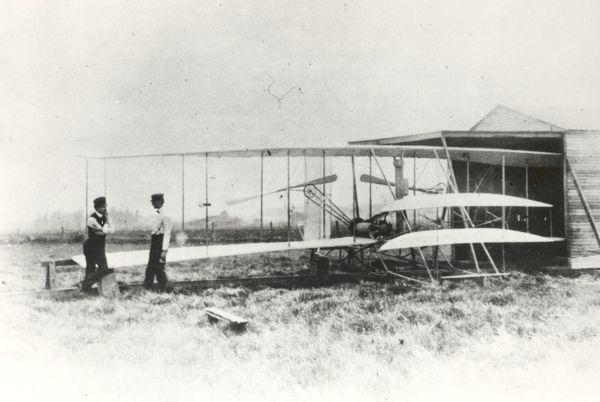 Wilbur and Orville Wright with the Flyer II at Huffman Prairie, outside of Dayton, Ohio, in May 1904.  The Wrights had a much more difficult time testing their aircraft at Huffman Prairie than at Kill Devil Hills, North Carolina, due to the lack of high winds