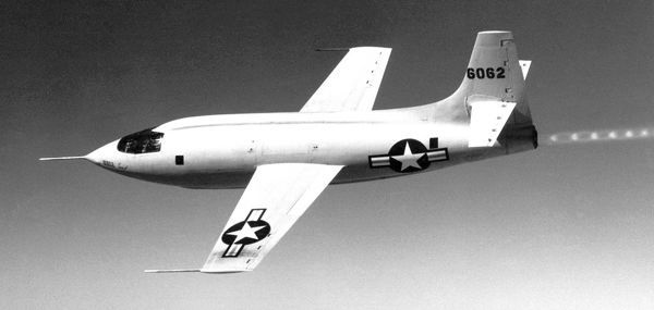 The Bell Aircraft Corporation X-1-1 (#46-062) in flight. The shock wave pattern in the exhaust plume is visible. The X-1 series aircraft were air-launched from a modified Boeing B-29 or B-50 Superfortress bombers